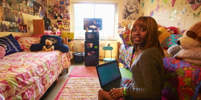 A student works on a computer in her residence hall room at Penn State Mont Alto.