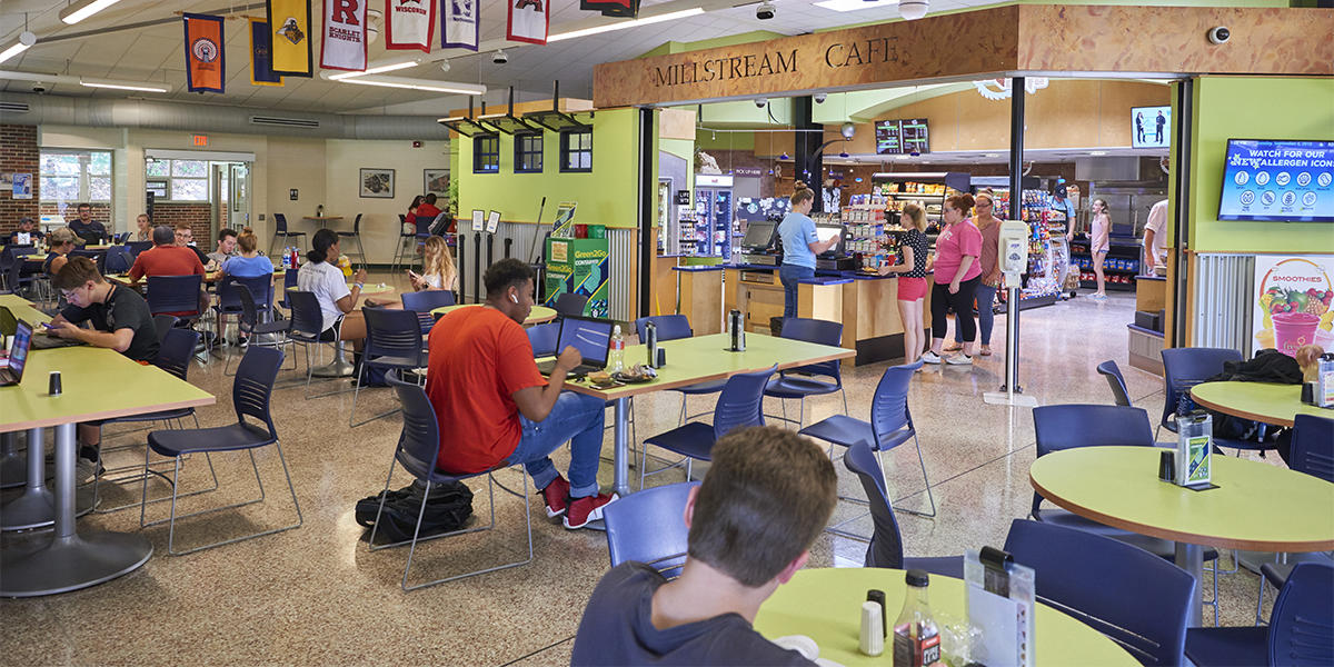 The Mill Cafe interior with guests at tables and being helped by the cashier